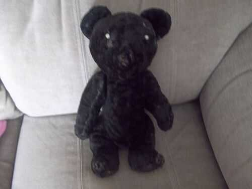 antique teddy bear black in worn condition needs new loving home.